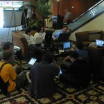 The hackers at the 2002 O'Reilly Emerging Technology Conference taking over the conference hotel lobby.