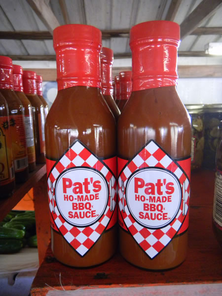 "Bottles of ""Pat's Ho-Made BBQ Sauce"""