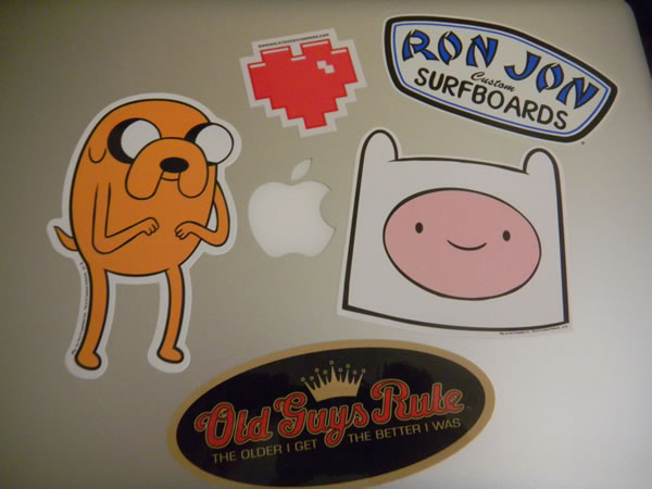 MacBook Pro top with stickers
