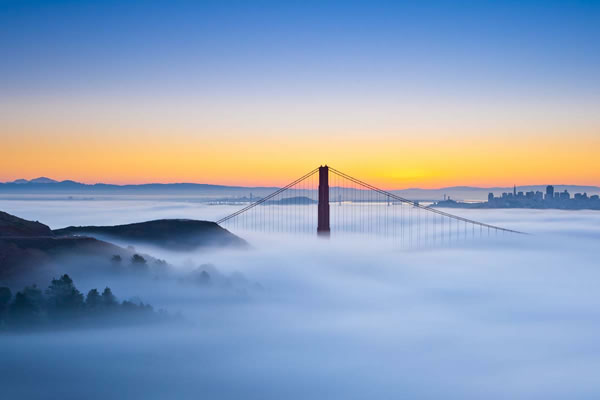 The Golden Gate Bridge, enveloped in fog.