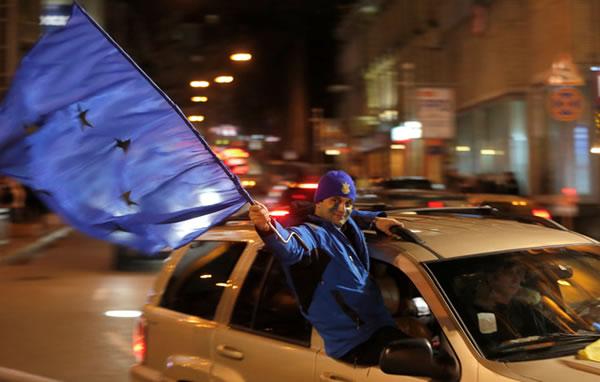 ukrainian waving EU flag