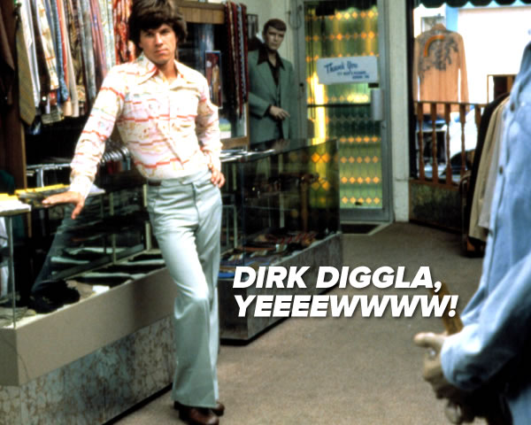 """DIRK DIGGLA, YEEEEWWWW!"": Mark Wahlberg as Dirk Diggler in Boogie Nights strikes a pose in a men's store in a very '70s shirt and baby blue slacks."