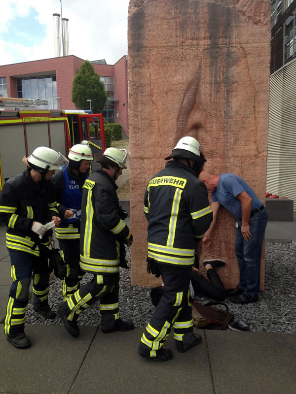 firefighters rescue guy trapped in giant vagina statue
