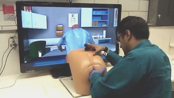 Doctor using butt-shaped interface for a prostate exam simulator