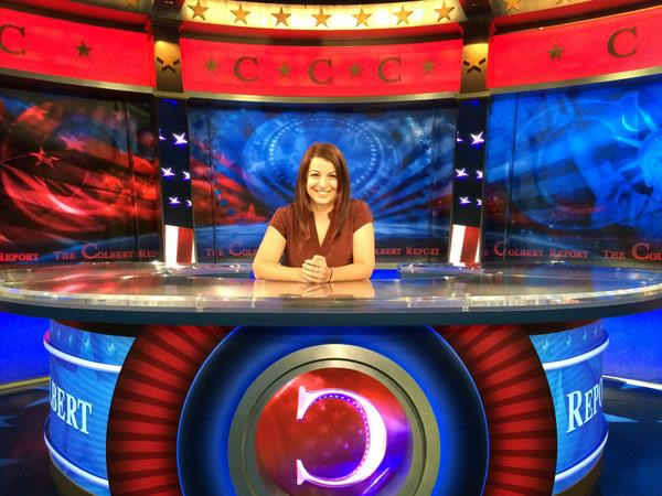 anita sarkeesian sitting at the colbert report desk