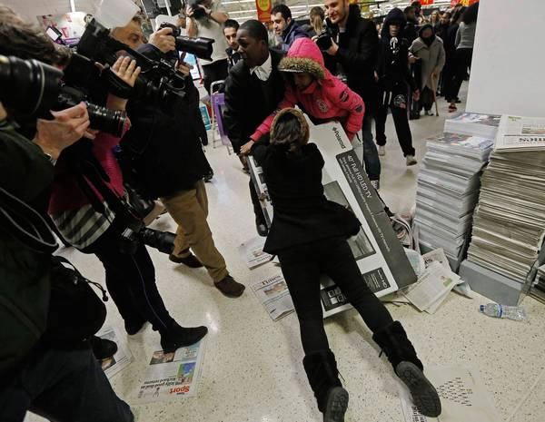 Two shoppers fighting over a TV set in Wembley, UK.
