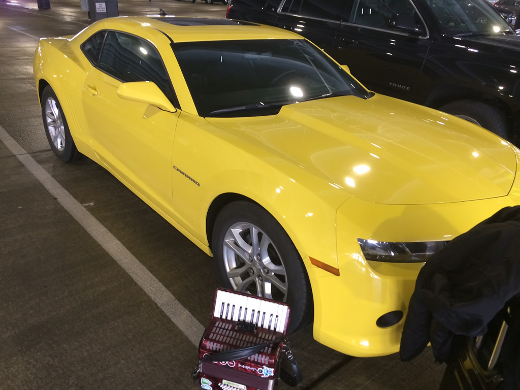 Photo: Joey deVilla's rental yellow Camaro and his accordion, side by side.