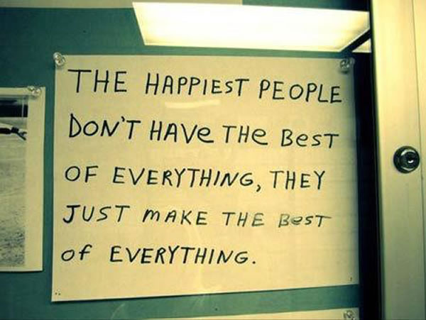 Photo: Handwritten sign with the text 'The happiest people don't have the best of everything, they just make the best of everything.'