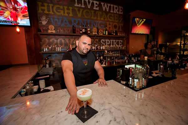 Photo: Bartender Ryan Pines at the edison food + drink lab's bar serving a Fire from Lima.