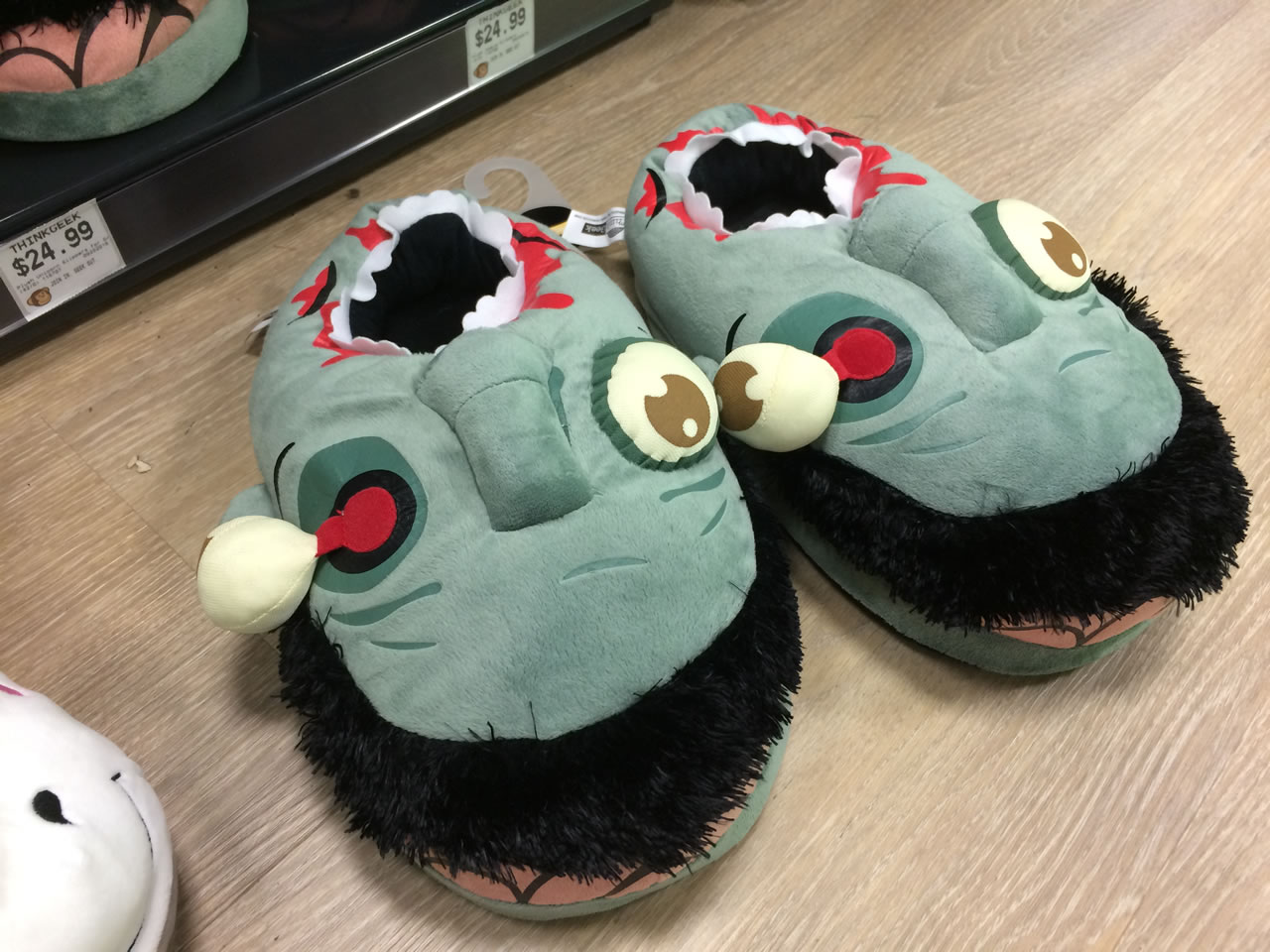 37 thinkgeek store - zombie slippers
