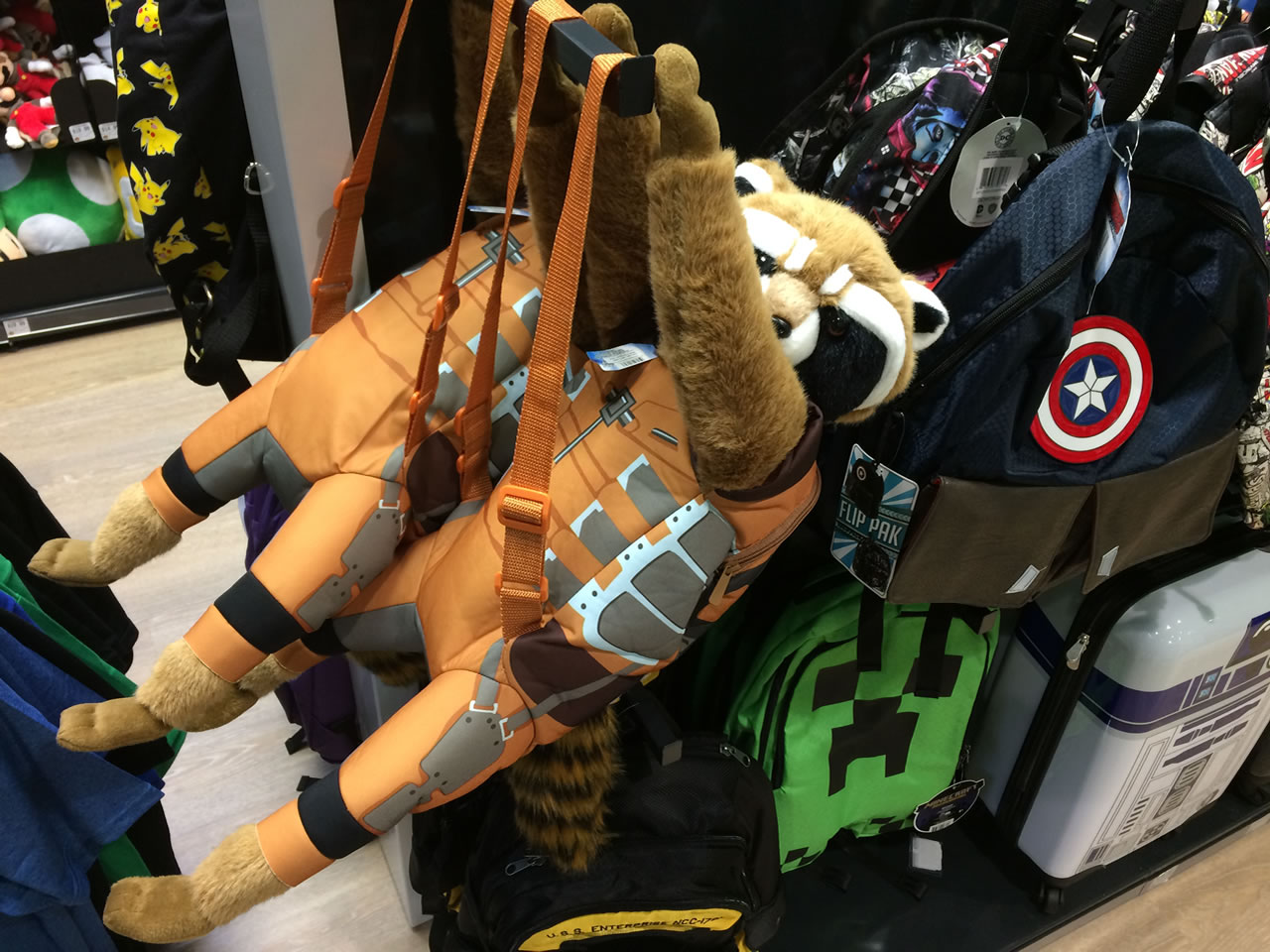54 thinkgeek store - rocket and captain america bags