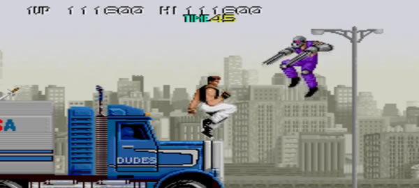 Gameplay scene from 'Bad Dudes vs. Dragon Ninja' videogame. The player fights ninjas atop a moving truck on the highway.