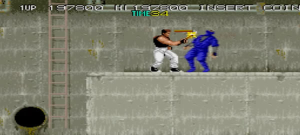 Gameplay scene from 'Bad Dudes vs. Dragon Ninja' videogame. The player fights ninjas in the sewers.