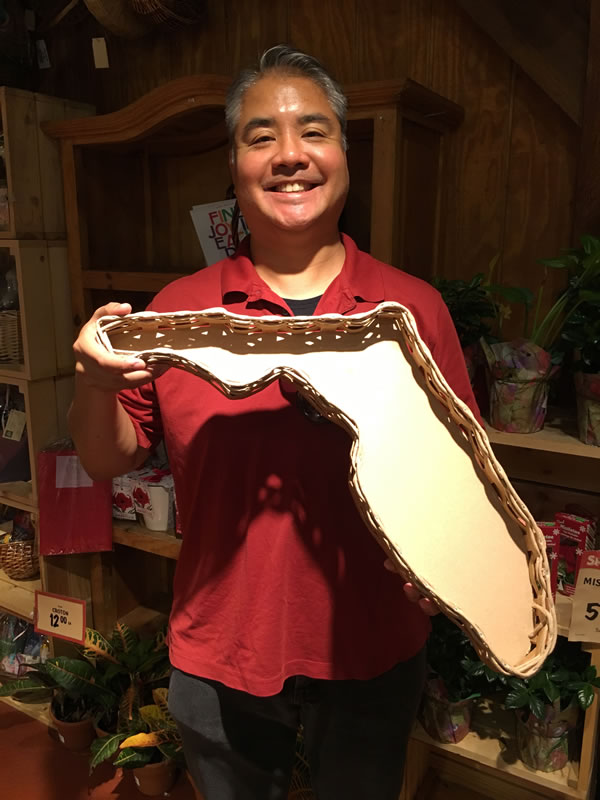 Joey deVilla poses with a Florida-shaped serving tray.