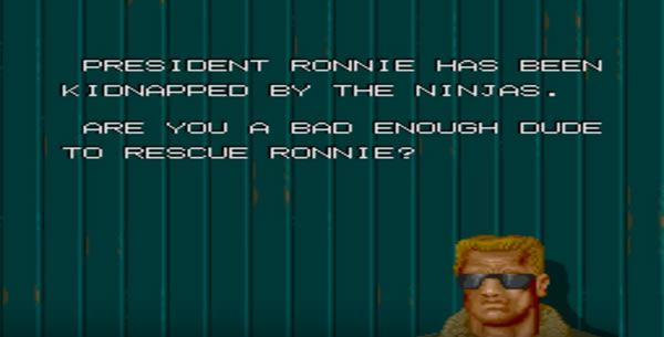 Intro screen from 'Bad Dudes vs. Dragon Ninja' videogame. An Arnold Schwarzenegger-like character in leather coat and sunglasses says 'President Ronnie has been kidnapped by the ninjas. Are you a bad enough dude to rescue Ronnie?'