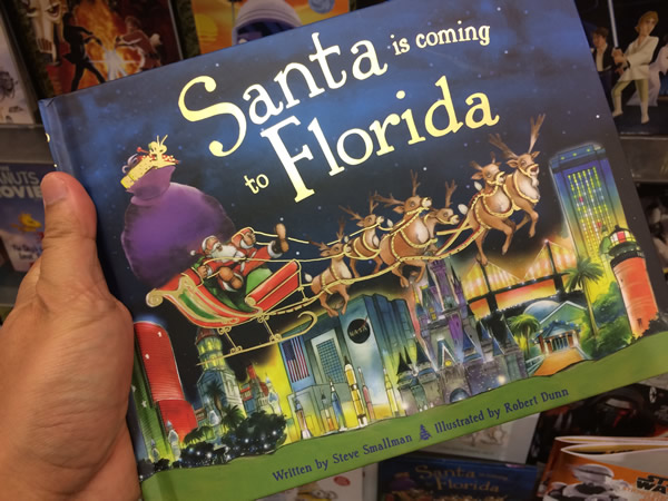 A book titled 'Santa is Coming to Florida'.