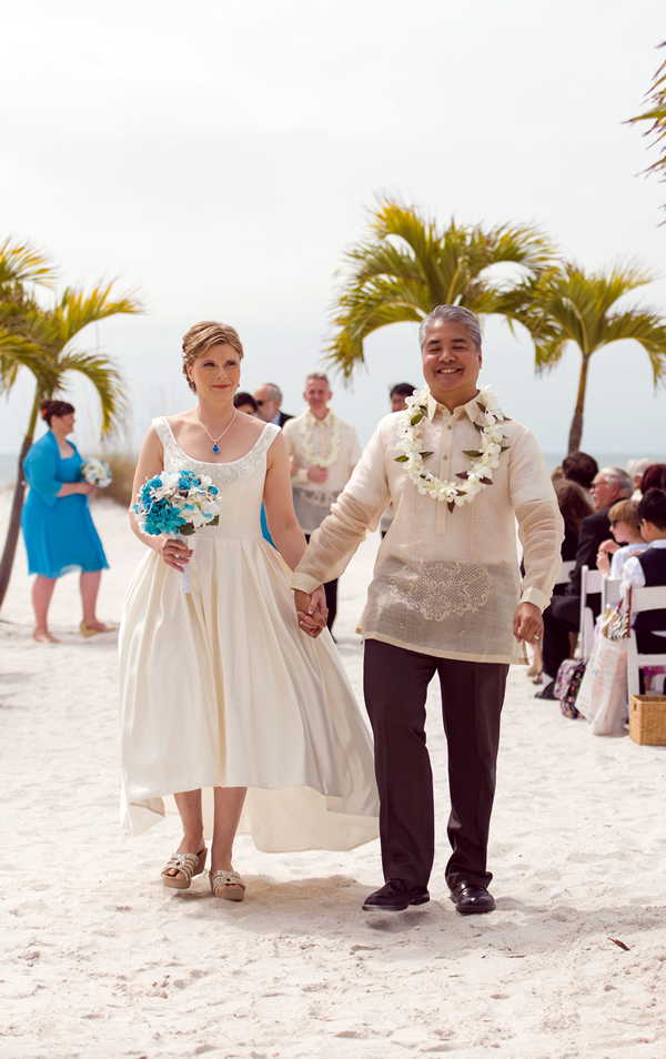 Anitra Pavka and Joey deVilla walk down the 'aisle' at their wedding on St. Pete Beach.