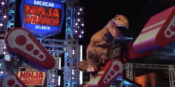 reko rivera in t-rex suit