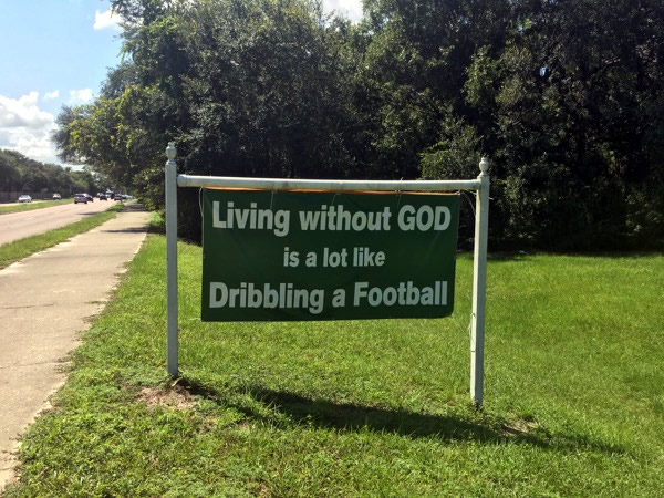 living without god is a lot like dribbling a football