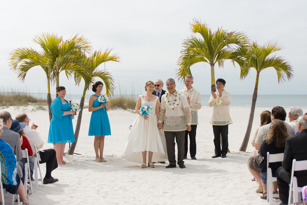 Anitra Pavka and Joey deVilla facing the guests as newly-married wife and husband at their wedding on St. Pete Beach.