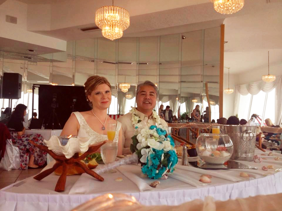 Anitra Pavka and Joey deVilla at the bridal table at their wedding.