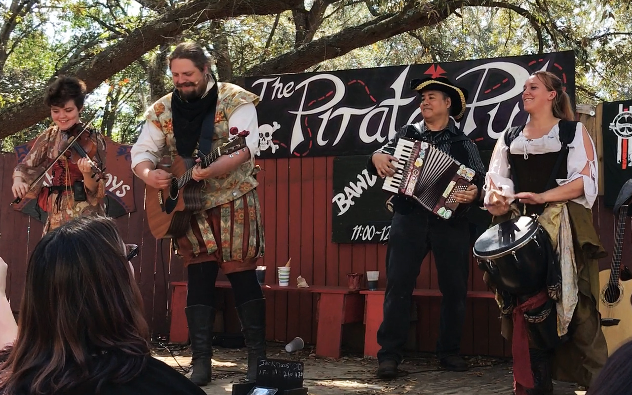 The Irish-American band The Jackdaws play with Joey deVilla. From left to right: Constance on violin, Whiplash on Guitar, Joey deVilla on accordion, and Roxy on the drum.