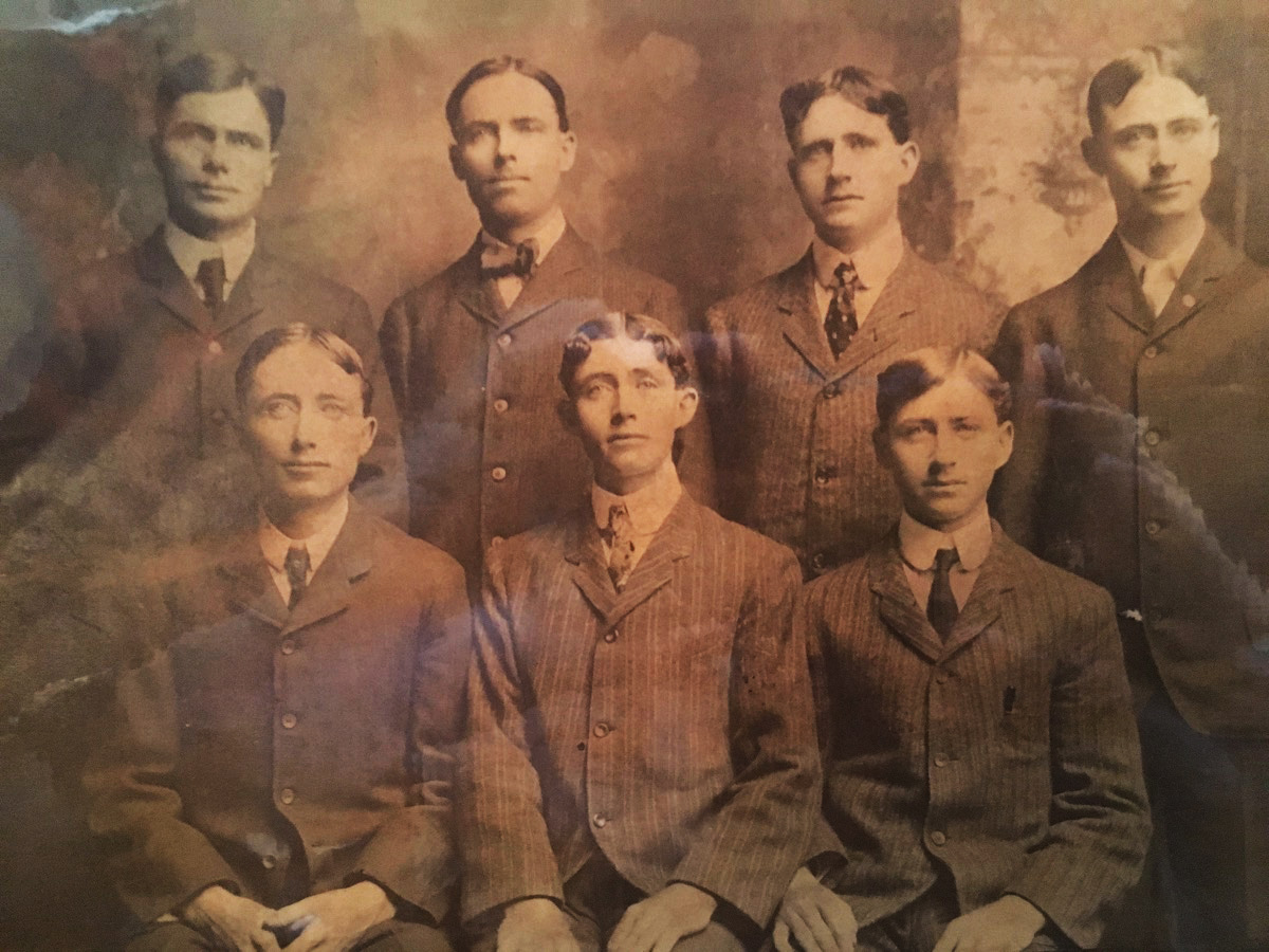 Antique photo of Seven O'Hara men, seated three in the front row, four in the rear, including James O'Hara (rear row, third from left).