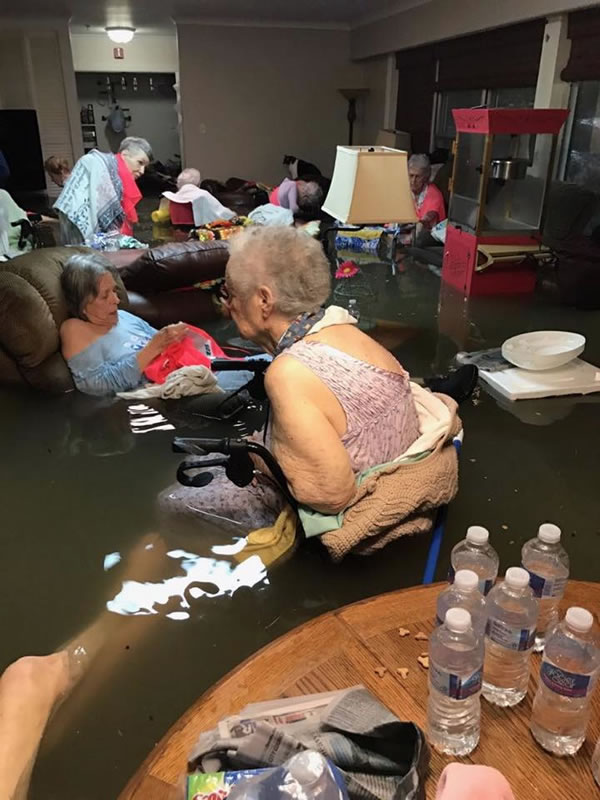 Residents of La Vita Bella Nursing Home in Dickerson, Texas wait for rescue in their flooded living room.