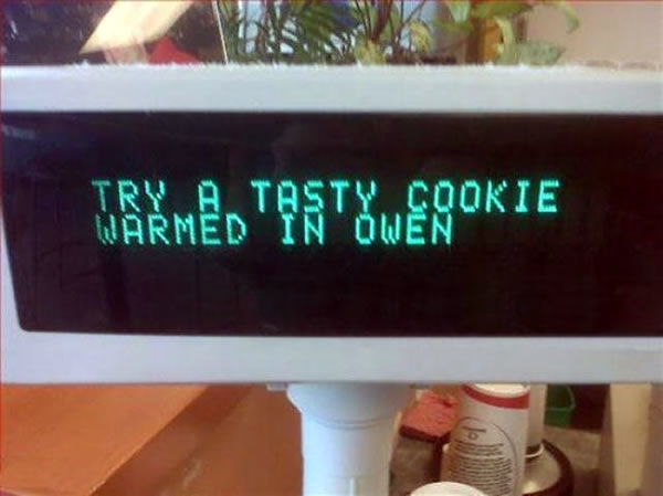 Grocery cash register digital readout that says 'Try a tasty cookie warmed in Owen'.