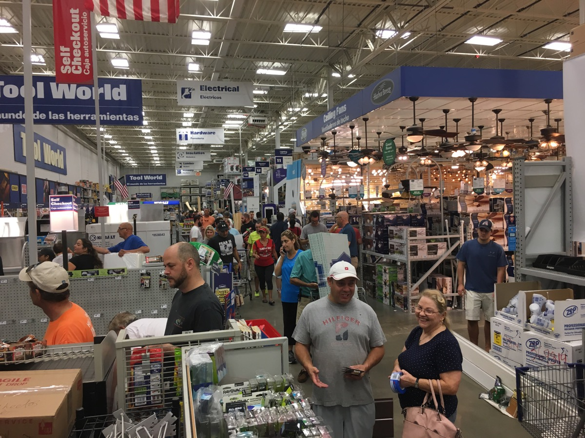 A very full Lowe's with cashier lines running the width of the warehouse store.