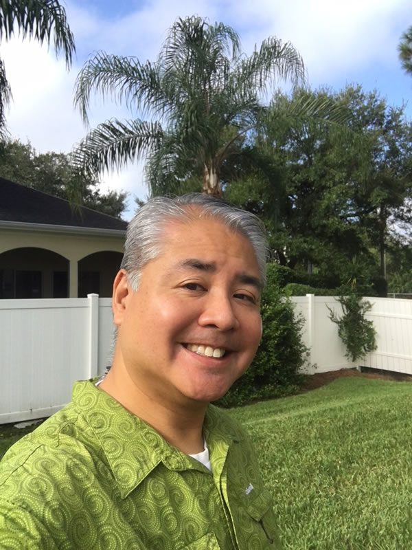 Joey deVilla poses in his yard with a blue sky in the background, on the morning of Friday, September 8, 2017.