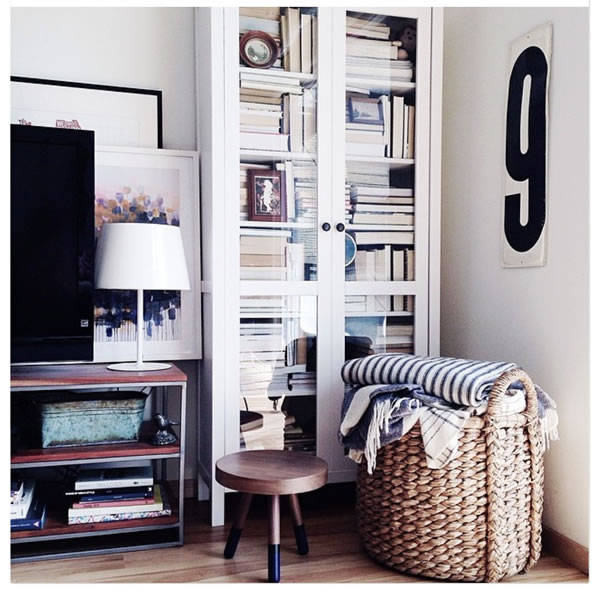 Which featured one couple whove decided to drop the pretense of bookshelves and simply admit that books are decorative widgets that you can use