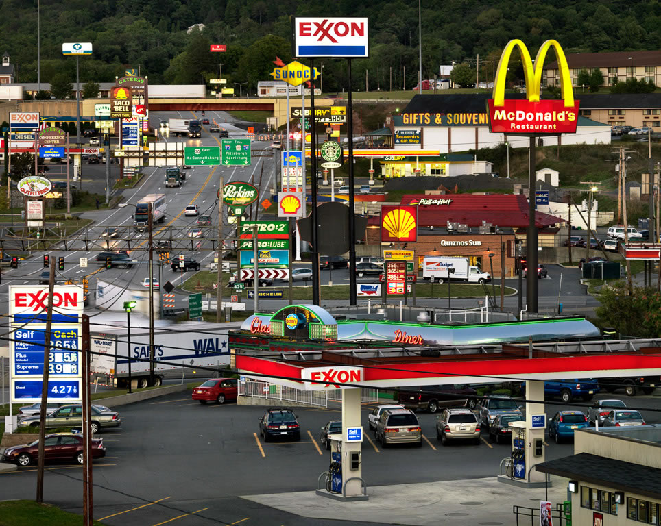 Photo: Edward Burtynsly's photo, 'Breezewood, Pennsylvania, USA', which shows the mess of gas stations, fast food restaurants, and gift shops by the highway exit at Breezewood, PA.