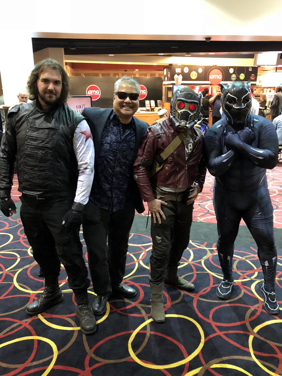 Photo: Joey deVilla poses Bryan Wolfe dressed as Black Panther, along with two guys dressed as Star-Lord and Winter Soldier.