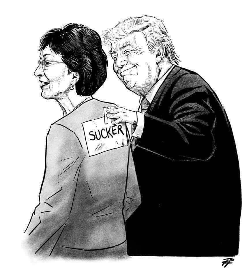 Editorial cartoon showing a smiling Senator Susan Collins standing beside Donald Trump as he tapes a sign labeled 'SUCKER' to her back.