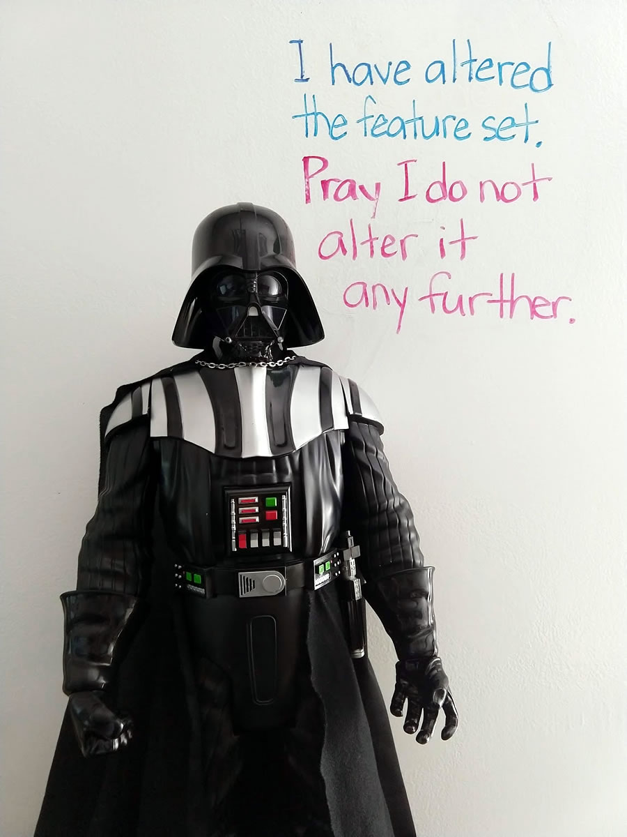 Status of Darth Vader with the caption behind him written on whiteboard: 'I have altered the feature set. Pray I do not alter it any further.'