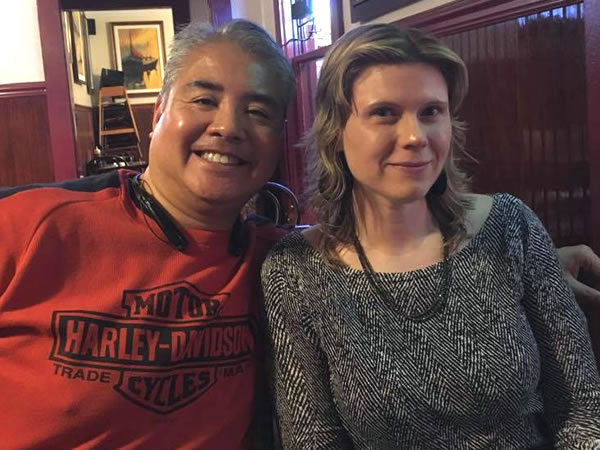 Joey deVilla and Anitra Pavka, sitting together and smiling in a booth at Kojak's Ribs, Tampa, January 2016.