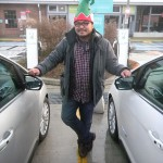 Rannie Turingan standing between two Ford C-MAX cars