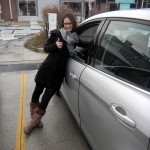 Julie Tyios leans up against one of the Ford C-MAXes.