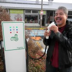 Joey deVilla licking the electric car charger