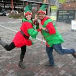 Sara Mercier and Rannie Turingan in elf costumes, striking a Busby Berkely dancing pose