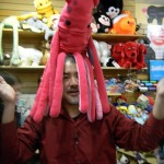 Joey deVilla poses with a plush squid on his head