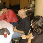 Nelson Minar, Clay Shirky, Wes Felter in conversation at a conference table.
