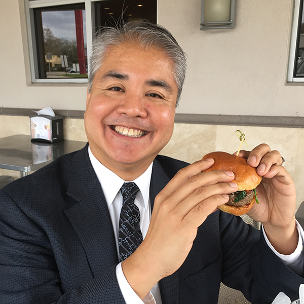 Joey deVilla eats a burger -- that most American of dishes -- after successfully acquiring a green card.