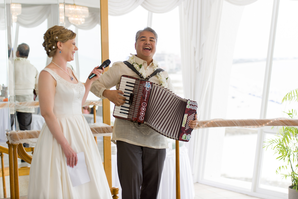 Anitra Pavka and Joey deVilla's wedding photo — Anitra smiles as Joey plays an accordion tribute to her.
