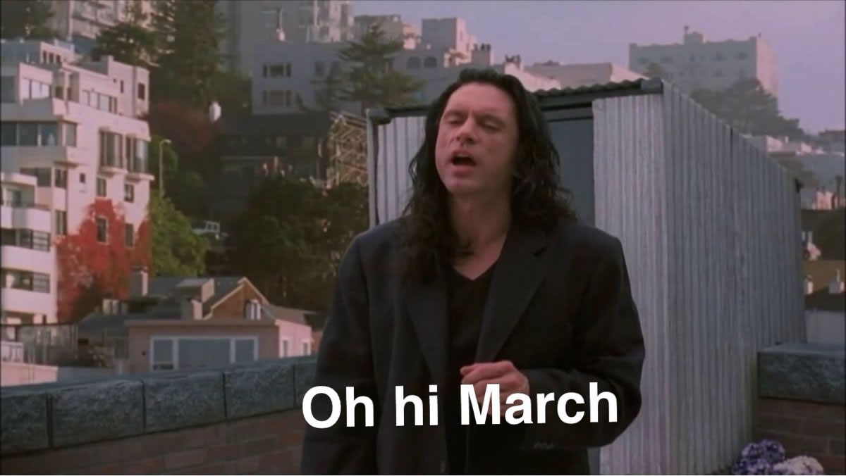 Still from the 'Oh hi, Mark' scene from 'The Room' showing Tommy Wiseau emerging from the staircase, subtitled 'Oh hi March'.