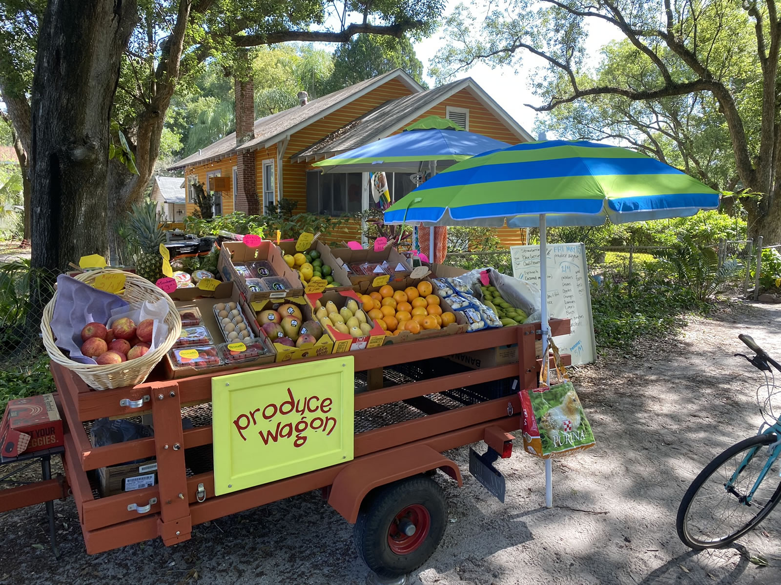 Closer-up photo of the Produce Wagon, showing its basket of apples, strawberries, eggs, mangoes, oranges, mushrooms, and bananas.