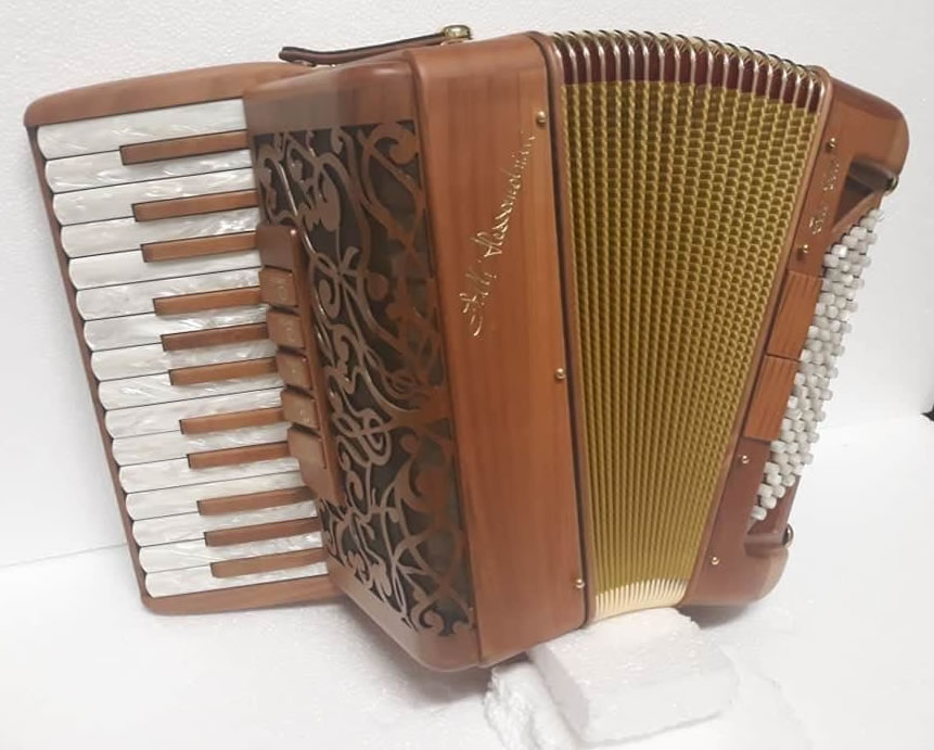 Photo: An Alessandrini Celt accordion, whose body is made entirely out of wood.