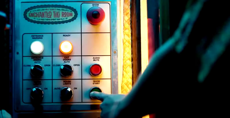 "Photo: A finger pushing a button labeled ""SHOW START"" on a control panel labeled ""ENCHANTED TIKI ROOM""."