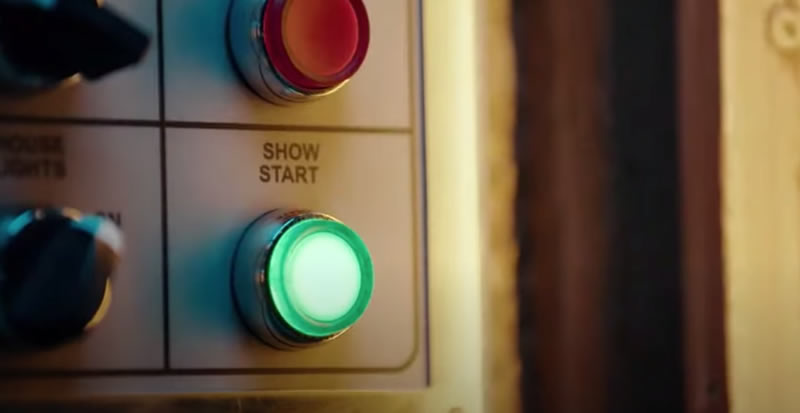 "Photo: Close-up of the ""SHOW START"" button on the ""ENCHANTED TIKI ROOM"" control panel."